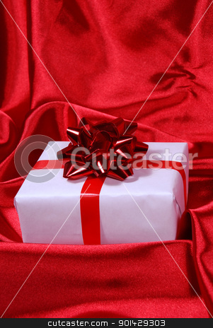 red gift box stock photo, red gift box on red satin background by sutike
