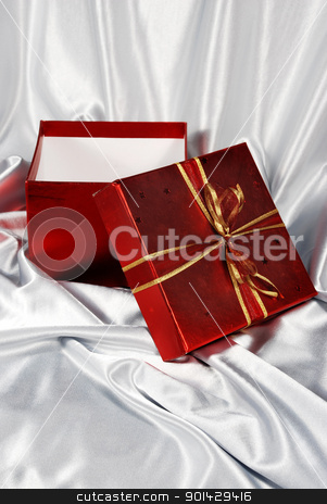 red gift box stock photo, red gift box on white satin background  by sutike