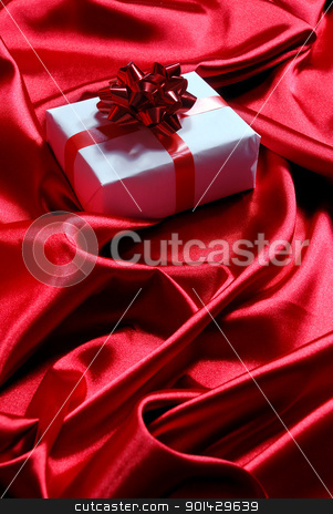 gift box on red satin background stock photo, gift box on red satin background by sutike