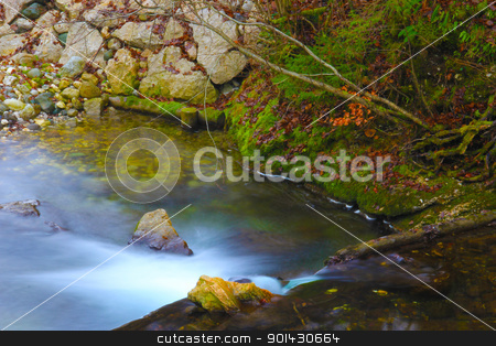 Fast river stock photo, fast river stream with small waterfall. by Primus