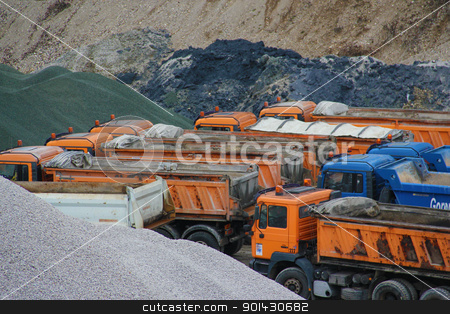 In the gravel pit stock photo, Trucks in the gravel pit. by Primus