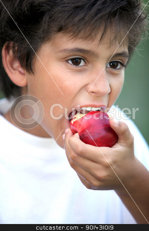 Boy eating an apple stock photo, Boy eating an apple by photography33