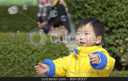 baby playing soap bubbles stock photo, baby playing soap bubbles by jackq