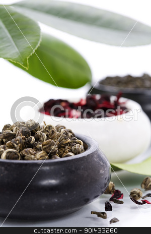 fresh tea stock photo, tree kinds of tea in bowls on white background by klenova