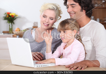 parents and their little girl having fun on the Internet stock photo, parents and their little girl having fun on the Internet by photography33