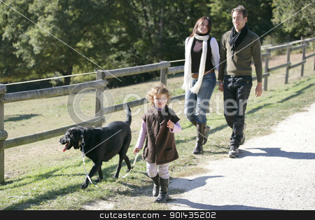 Family with dog in the countryside stock photo, Family with dog in the countryside by photography33