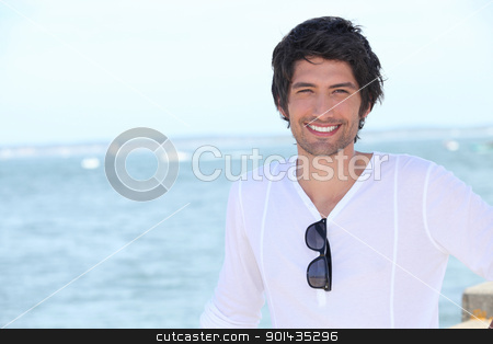 Young man by the sea stock photo, Young man by the sea by photography33