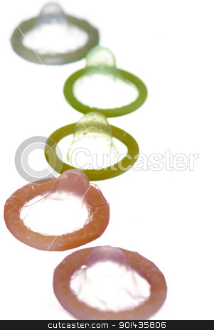 colorful condoms stock photo, a narrow depth of field view of some colourful condoms by Stephen Gibson