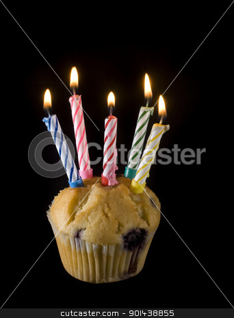 birthday cupcake stock photo, a small cupcake with 5 lit candles on top by Stephen Gibson