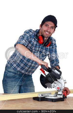 A carpenter with a circular saw. stock photo, A carpenter with a circular saw. by photography33