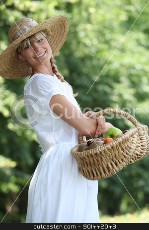 young woman with a basket of fresh fruits stock photo, young woman with a basket of fresh fruits by photography33