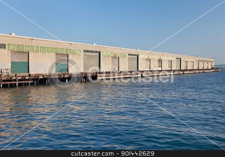 industrial pier stock photo, industrial pier in San Francisco waterfront with storage gates by Marek Uliasz