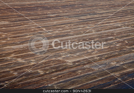 weathered wooden deck stock photo, rough weathered wooden deck with diagonal plank pattern by Marek Uliasz