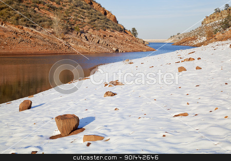 Colorado lake in winter scenery stock photo, Horsetooth Reservoir near Fort Collins, Colorado in  winter scenery with a dam in distant view by Marek Uliasz