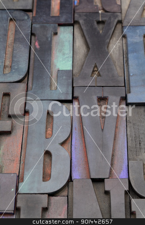 antique alphabet letters stock photo, antique wood letterpress printing blocks with color ink patina, random collection with L, X, V, and B letters by Marek Uliasz