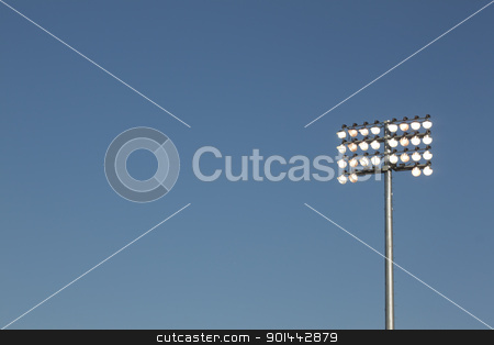 Stadium lights on a blue sky background stock photo, Stadium lights on a blue sky background. could be used for football, soccer, baseball, etc. by Jeremy Baumann
