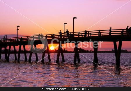 Fishing at Sunset stock photo, Fishing off the pier at sunset,Sarasota,Florida,USA by Delmas Lehman