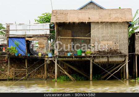 Rural Houses in Cambodia stock photo, Traditional fishermen wooden houses on stilts. Tonle Sap Lake in Cambodia, Kompong Khleang village. by Rognar