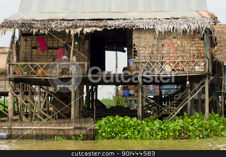 Rural Fishermen Houses in Cambodia stock photo, Traditional fishermen wooden house on stilts. Tonle Sap Lake in Cambodia, Kompong Khleang village. by Rognar