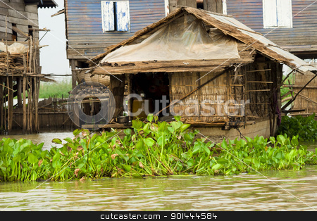 Fisherman Boat House stock photo, Traditional rural fisherman boat house on Tonle Sap Lake in Cambodia, Kompong Khleang village. by Rognar
