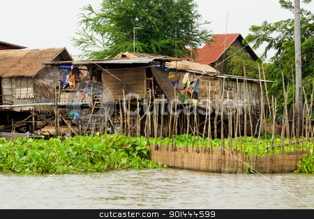 Wooden Houses on Stilts stock photo, Traditional fishermen wooden houses on stilts, Tonle Sap Lake in Cambodia, Kompong Khleang village. by Rognar