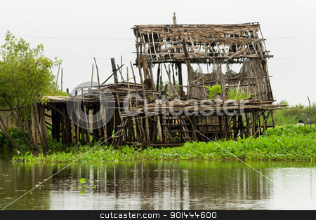 Abandoned House Remains stock photo, Ruins of an abandoned traditional fishermen wooden house on stilts, Tonle Sap Lake in Cambodia, Kompong Khleang village. by Rognar