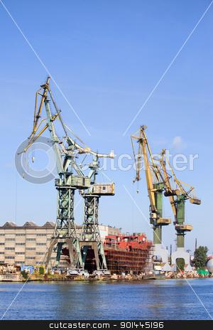 Shipyard Industrial Scenery stock photo, Industrial scenery, huge shipyard cranes and ship under construction by Rognar