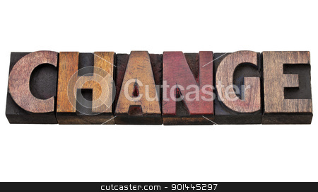 change word in letterpress type stock photo, change - isolated word in vintage wood letterpress type, stained by color inks by Marek Uliasz