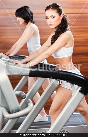 exercise in gym center stock photo, Women doing exercise in gym center by iMarin