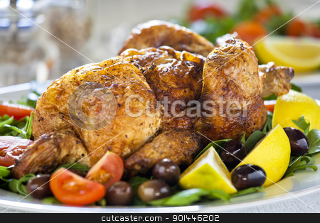 Grilled Chicken stock photo, Close up photograph of a grilled chicken with tomato and olives by mpessaris