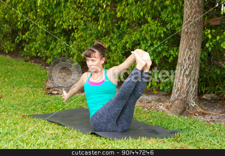 woman doing yoga pose navasana variation or boat pose