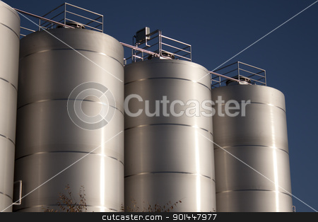 Factory for Industrial Manufacturing stock photo, large beer manufacturing plant. could also be a large dairy farm. by Jeremy Baumann