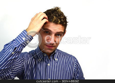 Attractive guy scratching his head stock photo, Good looking young man thinking by Stefano Cavoretto