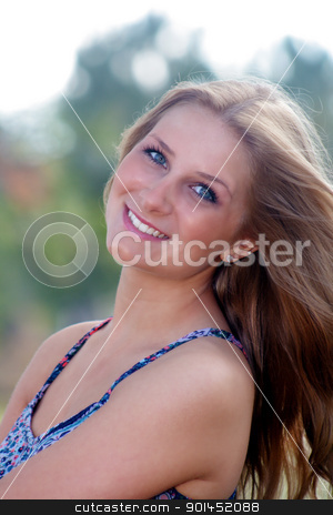 Beautiful Young Blonde Outdoors (1) stock photo, A close-up of a lovely young blonde with a heartwarming smile outdoors. by Carl Stewart