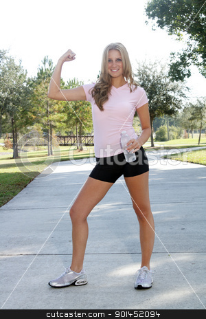 Beautiful Young Blonde Outdoors (7) stock photo, A lovely, young blonde with long, beautiful legs and wearing fitness wear, flexes her muscles outdoors. by Carl Stewart