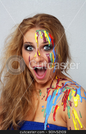 Beautiful Young Blonde, Headshot (7) stock photo, A studio close-up of an excited, lovely young blonde with several colors of paint poured and dripping on her. by Carl Stewart