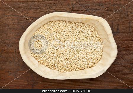sweet brown rice stock photo, sweet brown rice grain in a rustic wood bowl against grunge dark wooden table surface, top view by Marek Uliasz