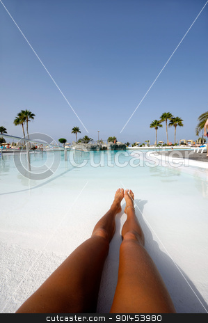 Long legs in pool stock photo, Woman with long legs in a refreshing pool. by Lars Christensen
