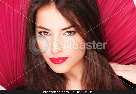 lady on red stock photo, Pretty lady in front of red fans by iMarin