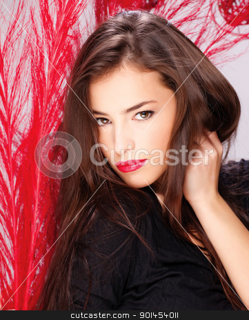 woman near red feathers stock photo, Pretty lady in front of red feather by iMarin
