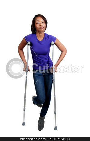 Black Woman on Crutches stock photo, A beautiful African American black woman using a set of medical crutches to help her walk by Robert Byron