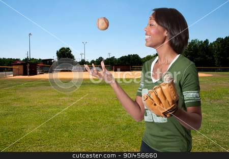 Baseball Player stock photo, Black African American woman playing baseball at a community park by Robert Byron