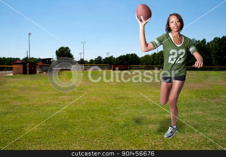 Black Woman Football Player stock photo, Beautiful black African American woman playing football by Robert Byron