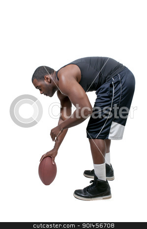 Black Man Playing Football stock photo, Black African American man playing a game of football by Robert Byron