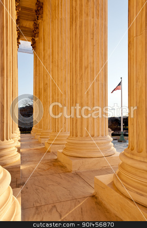 Pllars of Supreme court and US Flag stock photo, Late afternoon winter sun illuminates front of supreme court in Washington in winter with view of US flag by Steven Heap