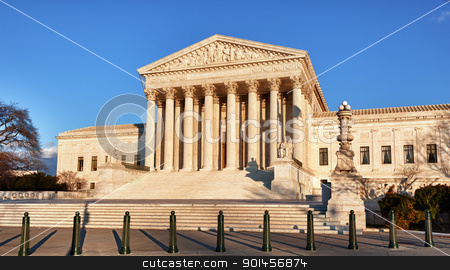 Winter trees frame Supreme court stock photo, Late afternoon winter sun illuminates front of supreme court in Washington in winter by Steven Heap