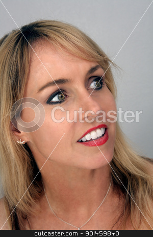 Beautiful Blonde Headshot (2) stock photo, Studio close-up of a lovely blonde with a captivating smile. by Carl Stewart