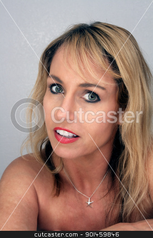 Beautiful Blonde Headshot (4) stock photo, Studio close-up of a lovely blonde with a captivating smile. by Carl Stewart