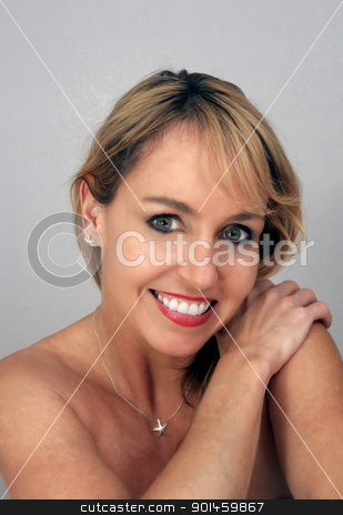 Beautiful Middle-age Blonde Headshot (6) stock photo, Studio close-up of a lovely blonde with bare shoulders and a captivating smile. by Carl Stewart