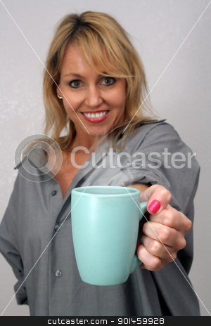 Beautiful Blonde Offers a Cup of Coffee stock photo, A lovely blonde extends a cup of hot coffee, tea, or cocoa.  Selective focus on the cup. by Carl Stewart